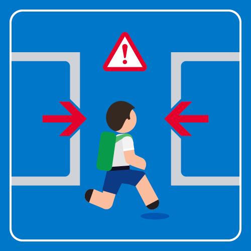 Student is running towards closing light rail doors.