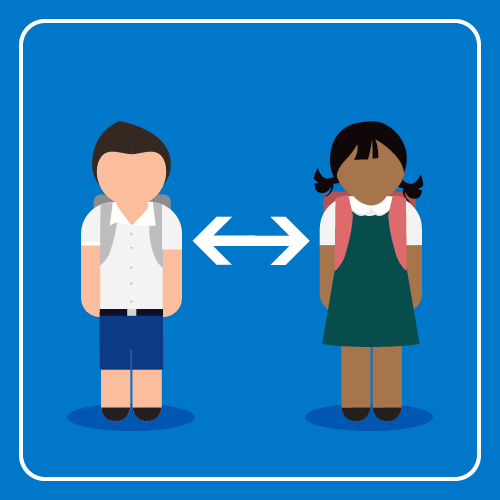 Two students are standing next to each other ensuring there is physical distance between them.